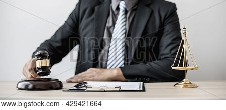 A Lawyer Or Legal Advisor Holding A Small Hammer For A Judge's Table In Court Is About To Pound On T