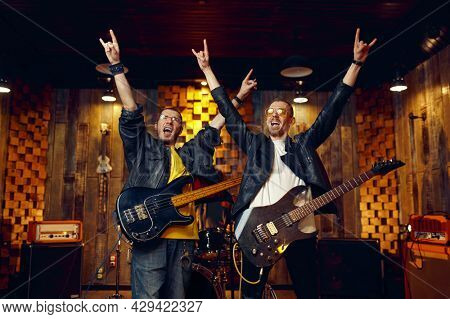 Two artists with electric guitars, rock band