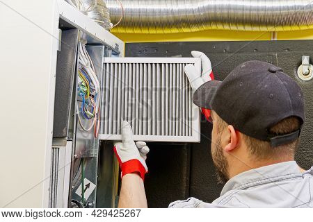 Hvac Service Technician Changing Dirty Air Filter In The Central Ventilation System