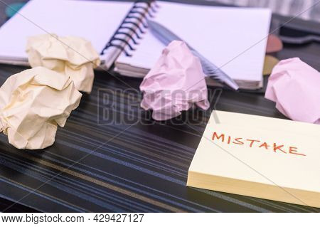 Mistake Written On Sticky Notes. Learning, Wrong, Blooper, Error Message, Regret Sayings Background.