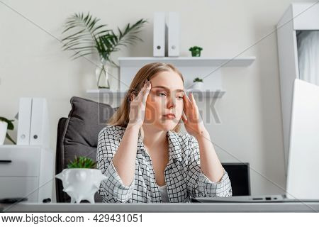 Upset Young Woman In Stress Do Office Work Via Laptop. Depression Tired Young Woman Have Headache Du