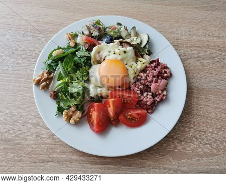 A Healthy And Tasty Summer Breakfast. Soft Boiled Egg, Buckwheat Groats, Colorful Vegetables And Nut