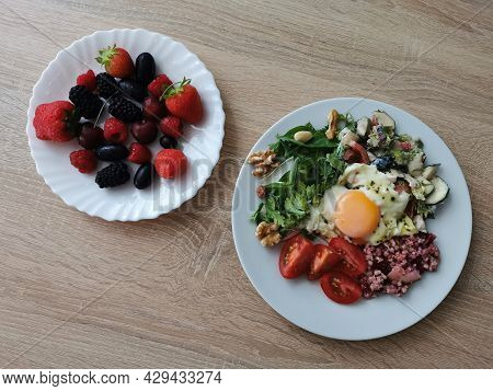 A Healthy And Tasty Summer Breakfast. Soft Boiled Egg, Buckwheat Groats, Colorful Vegetables, Nuts