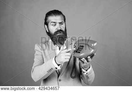 Access The Tech. Bearded Man In A Suit Holding Retro Phone. Stay Connected. Customer Service Concept