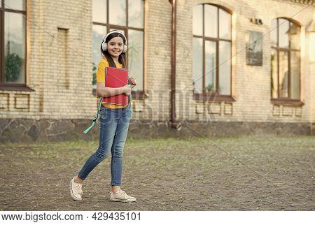 Make Learning More Enjoyable. Little Child Wear Headphones Outdoors. Modern Technology In Education.