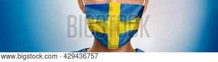 Sweden flag print on swedish doctor nurse man or woman face PPE on blue background panoramic banner. Coronavirus concept.
