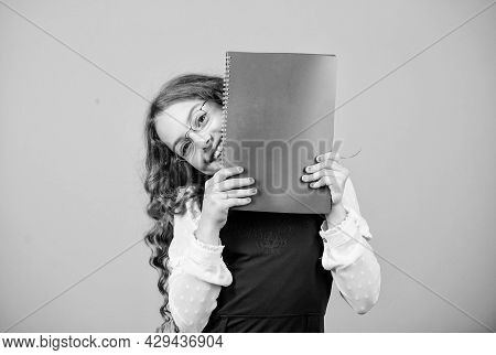 School Exam Concept. Final Exam Coming. Girl Hold Textbook Folder Test. Preparing To Exams In Librar