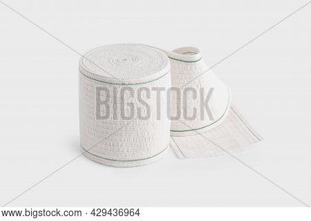 Sterile Medical Bandage Roll For Broken Bone Or Release Pain. Elastic Bandage Roll On White Backgrou