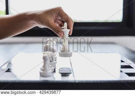Businesswoman Holding White Chess Pieces On A Chessboard, Comparing Chessboard To Business Administr