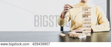 Businesswoman Playing With Wooden Blocks, Comparing Business Management Concepts On Risk, Planning H