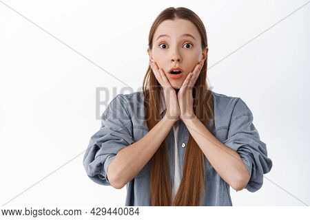 Surprised Young Woman React To Big News, Gasping And Look In Awe, Raise Eyebrows And Open Mouth, Hol