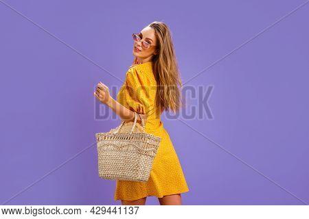 Fashionable Woman In Nice Yellow Dress And Straw Handbag. Fashion Spring Summer Photo