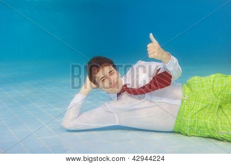 Businessman Underwater With Thumbs Up