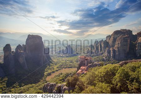 Wonderful Panoramic View Of Meteora Valley. Sunny Landscape With Colorful Sky Over The Mountain Vall