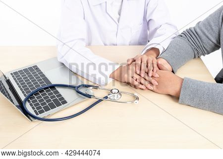 The Doctor Put Her Hand On Hand Of A Patient To Comfort And Encourage, With White Background To Peop