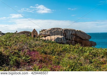 Old Stone Dwelling Along Lighthouse Mean Ruz, Port Of Ploumanach, In The Town Of Perros-guirec, Cote