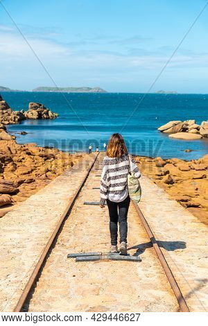 A Young Woman On The Way To Descend The Boats Next To The Mean Ruz Lighthouse, Port Of Ploumanach, I