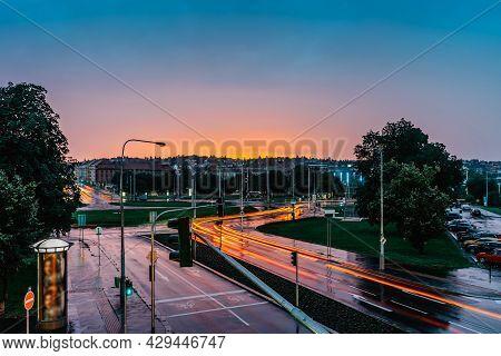 City Traffic Lights In Rainy Evening,prague,czech Republic.long Exposure Lights.movement Of Cars At