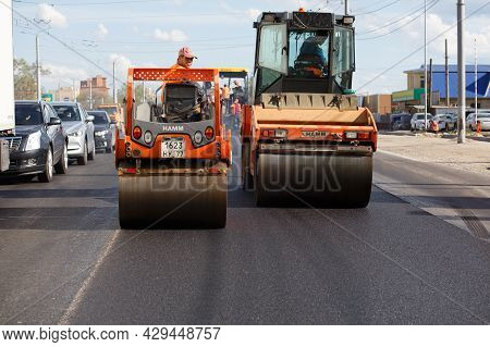 Tula, Russia - May 16, 2021: Process Of Asphalting, Two Road Steam Rollers During Road Construction