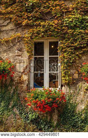 Houses Full Of Green Leaves In The Medieval Village Of Rochefort-en-terre, Morbihan Department In Th