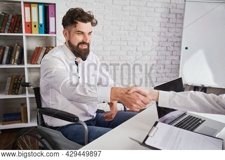 Happy Man With Disability Shaking Hands With Hr