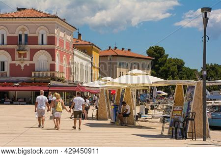 Porec, Croatia- July 10th 2021. Day Trip Vendors Selling Boat Trips At The Seafront Wait For Custome