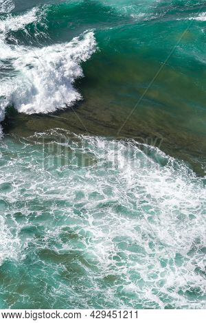 Aerial View Of The Atlantic Ocean Waves. Blue Water Background Texture