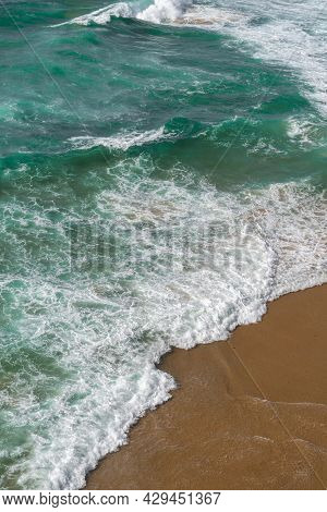 Aerial View Of The Ocean Waves. Blue Water Background. Sea Top View. Atlantic Ocean Beach With Sand