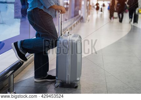 Flight Cancelled On Covid-19 Virus Disease Concept, Asian Traveler Senior Hold Luggage At Terminal A