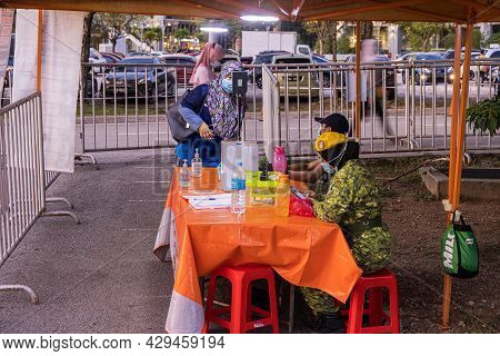 Kuala Lumpur, Malaysia - October 16, 2020: Entry Control With Smartphone App And Temperature Measure