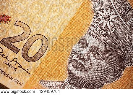 Macro Close-up Of 20 Malaysian Ringgit. Extreme Close Up Of Rm20 Malaysia. Portrait Of The First Kin