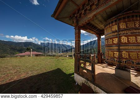 Paro, Bhutan - October 04, 2020: A Buddhistic Prayer Drum In The Mountains Of Buthan. The Translatio