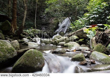 Waterfall At The Rainforest Of Sarawak, Borneo, Malaysia. Water Falls In A Small  Creek In The Jungl