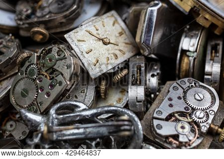 Macro close up of antique vintage broken watches, wrist watch or wristwatch movements and parts for repair. Time concept photograph.