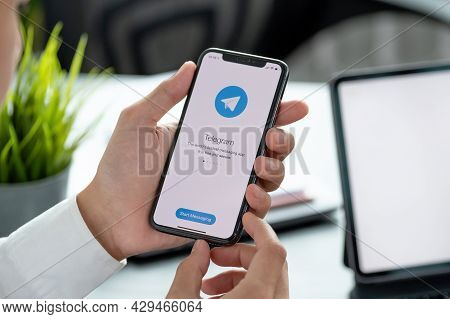 Chiang Mai, Thailand, Apr 06, 2021 : Man Hand Holding Iphone X With Social Networking Service Telegr