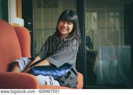 Asian Teenager Toothy Smiling Face ,relaxing In Home Living Room