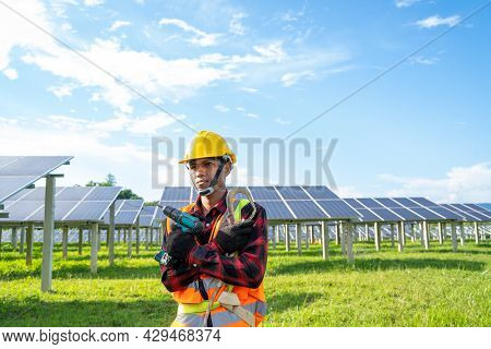 Engineer Or Electrician Working On Replacement Solar Panel At Solar Power Plant,concept Solar Power