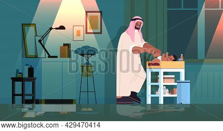 Sad Arab Father Changing Diaper To His Little Son Fatherhood Parenting Concept Dark Night Home Livin