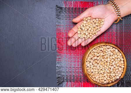 Uncooked Dried Chickpeas On Table. Heap Of Legume Chickpea. Copyspace