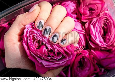 Amor Word On Nails Manicure Hold Pink Rose Flower. Love, Minimal Flat Lay Nature. Female Hand. Creat