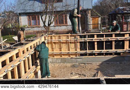 Kyiv, Ukraine - July, 26, 2021:concrete Foundation Construction. The Building Contractors Are Instal