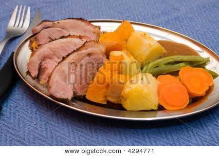Roast Lamb Dinner With Knife And Fork