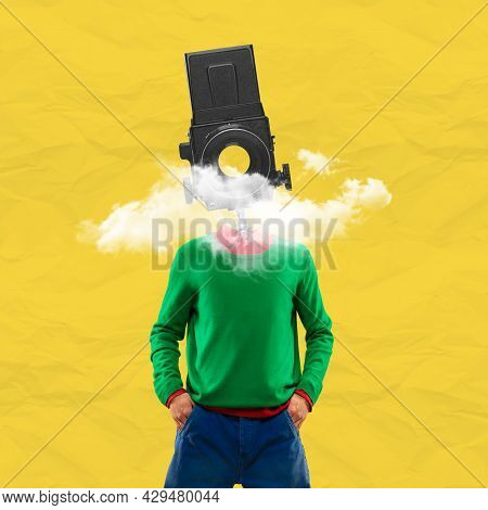 Surrealism. One Young Man In Retro Style Clothes Headed With Old Camera. Creative Image
