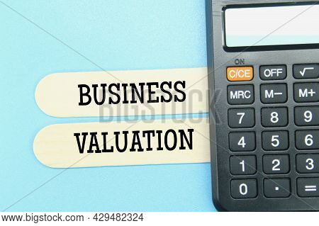 Calculator, Ice Cream Stick With The Word Business Valuation. Business Concept
