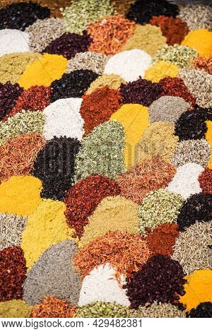 A Mix Of And Herbs For The Preparation Of Aromatic Dishes Of Indian And Asian Cuisine. Indian Backgr