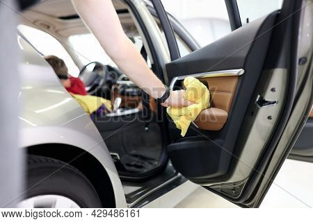 Car Interior And Door Handles Cleaning Closeup