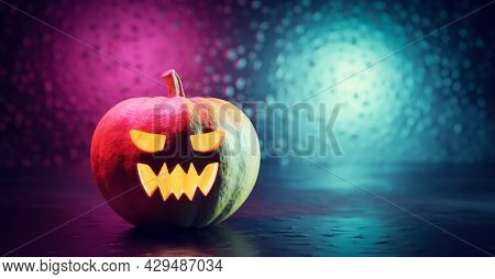 Halloween pumpkin glowing. Jack-o'-lantern scary carved face. 3D illustration