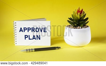 Approved Plan. The Text Approved Plan Is Written On A Notebook With A Cactus On A Yellow Background.