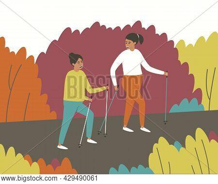 Girlfriends Walk In A Scandinavian Gait. Women Leisurely Strolls Through The Park. Autumn Nature. Ac