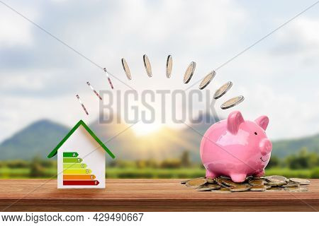 Silver Coins Flow From Energy-efficient Home Models To Piggy Banks, Innovative Energy-saving Home Id